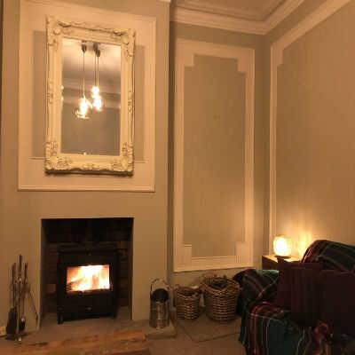 Living room showcasing a trio of Rowan pendants and a Zenza Gold Ball Filisky Table lamp.