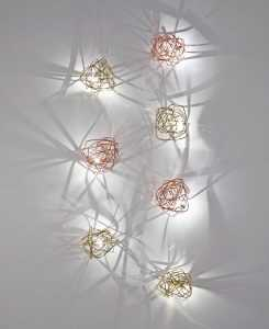 The Doodle Wall Light Gold Plated and The Doodle Wall Light Copper photographed together.